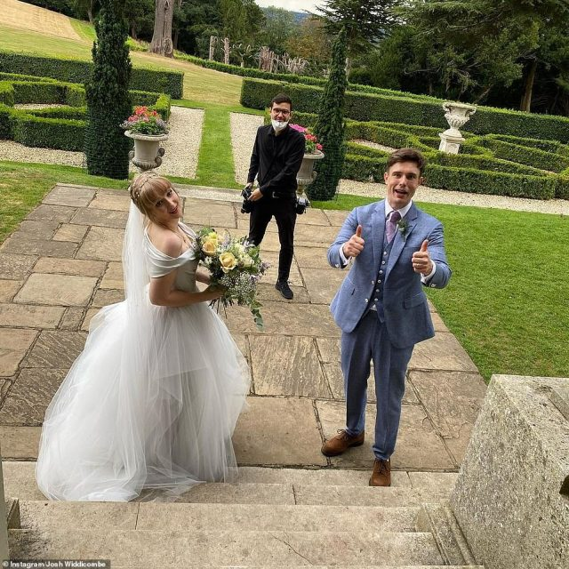 I do: Ed looked dapper in a three-piece blue suit, while bride Charlie stunned in a satin white dress with pleated skirt and a long embellished veil