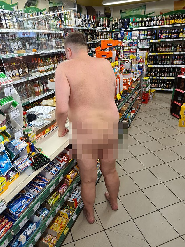 The prosecutor, who has been identified as Maciej W. by local media, is seen walking to the shop's checkout clutching a four pack of beer before paying and wandering the streets
