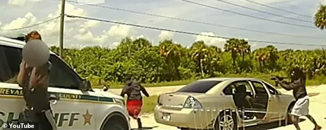Dashcam footage shows the moment Florida deputies Brian Potters and Tyler Thoman are ambushed by an armed Paris Wilder (right), 38, prompting a shootout that left Wilder dead and Potters severely injured