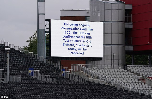 A message on a big screen at Old Trafford confirms the decision to cancel the fifth Test