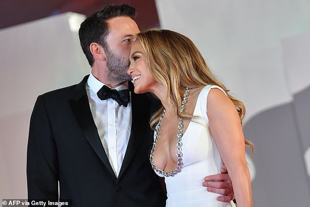 Happy:Jennifer, 52, wowed in a low-cut white dress with a silver detail along the plunging neckline