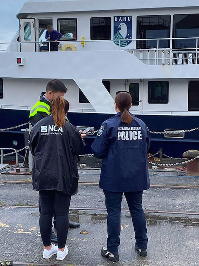The operation was carried out by the NCA in conjunction with the Australian Federal Police (AFP) and Border Force (Pictured: Officers from all three forces at scene of boat seizure)