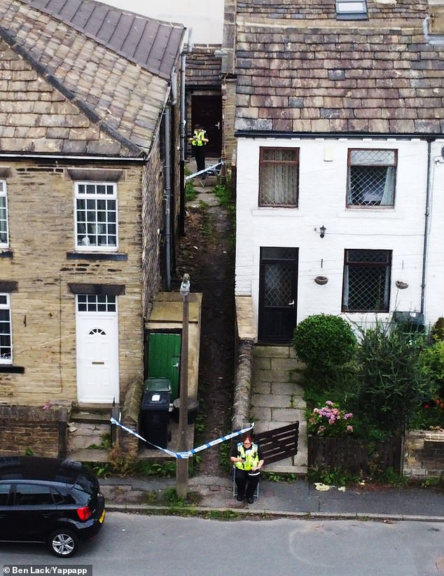 Pictured: A view from above down the alleyway where an 18-year-old girl was raped on Friday