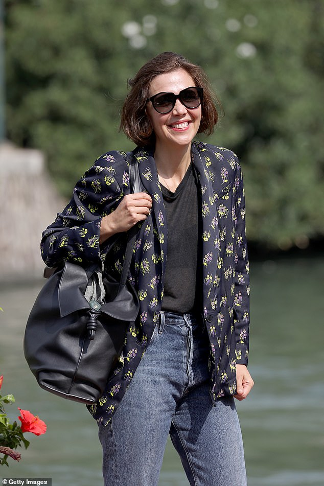Happy: Maggie Gyllenhaal appeared in high spirits as she rocked a casual figure in a navy floral blazer during the final day of the Venice Film Festival on Saturday