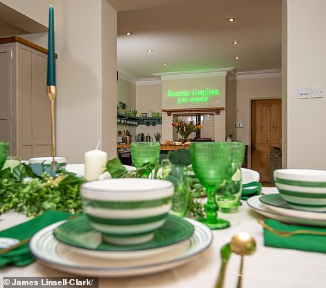 The home is filled with touches of green to reflect Boursin's branding – including cups and saucers and a sign reading 'Boursin Inspire, You Create'.