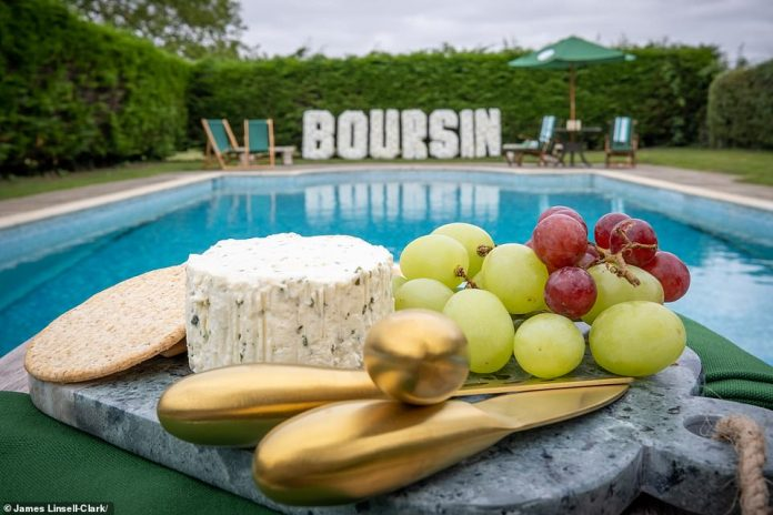 The property also features an outdoor heated pool - where guests can lounge and eat bourcin or enjoy games and games