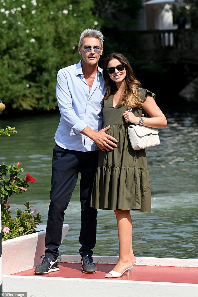 What a pair!  Roberto Farnese, 52, looked overjoyed after rocking his girlfriend's baby bump as she stepped onto the red carpet jetty.