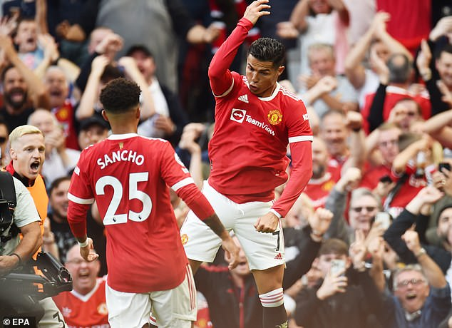 Ronaldo celebrates after netting his second goal against Newcastle in a dream return to Old Trafford