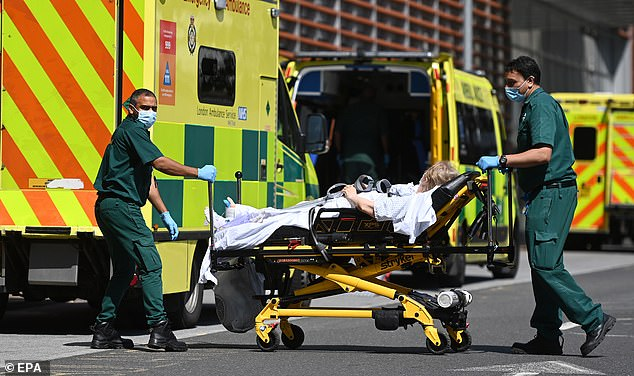 It emerged that social care funding was to be merged into a larger scheme giving the NHS a further £36b over three years. Pictured:Ambulance staff at the Royal London hospital