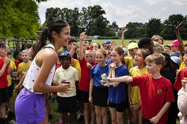 All eyes have been on Emma Raducanu (pictured visiting Bickley Primary School) in the US Open – but there have been two notable absentees from the crowds: her parents