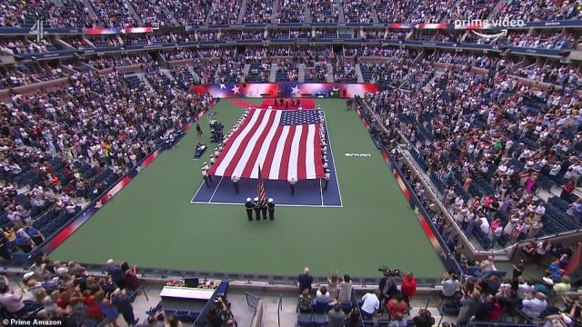 The match was preceded by a poignant ceremony to mark the 20th anniversary of 9/11, with a massive Stars and Stripes flag unfurled by female cadets, while a '9-11-01' stencil has been painted onto the court