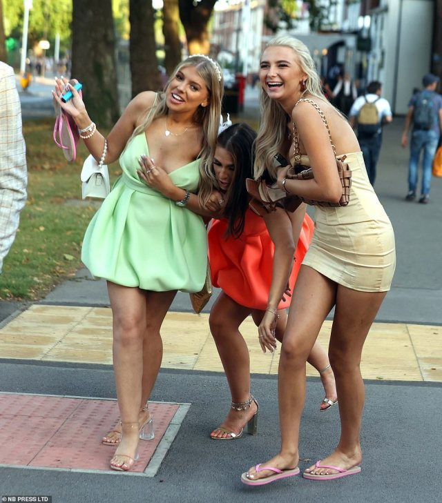 Doncaster race revellers swap their shoes for flip-flops after a long day before heading into the town centre