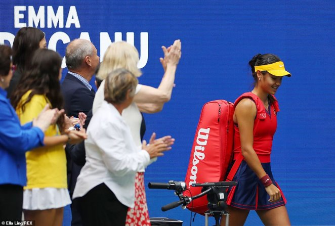 Raducanu and her opponent walk out to rapturous applause at the Arthur Ashe Stadium in Flushing Meadows
