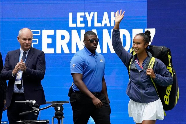 Fernandez of Canada waves to the fans as she takes to the court ahead of the final clash