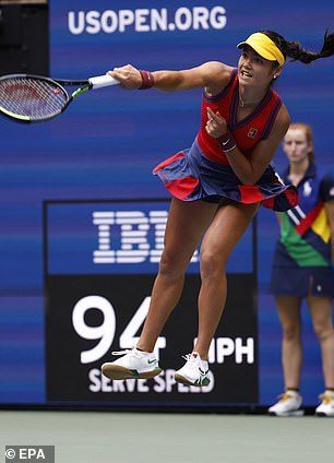 Raducanu leaping into the air to fire off a serve