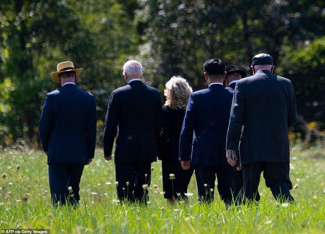 The Bidens walk through Shanksville, western Pennsylvania, where Flight 93 crashed on September 11 2001
