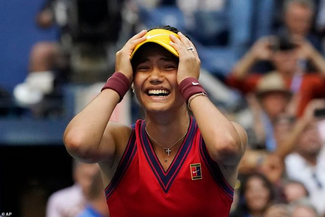 Emma Raducanu holds her head in her hands after beating Leyla Fernandez in the Arthur Ashe Stadium in front of 24,000. Life will never be the same again for the teenager as she claims a £1.8 million cheque - more than her entire career winnings to date - as well as moving up in the rankings from 150 to 23