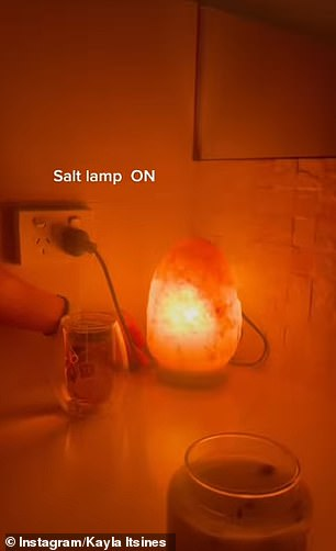 After turning off the lights, Kayla switches on her Himalayan salt lamp, which is said to help improve sleep