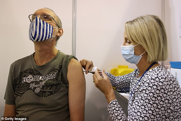 Mr McGowan has refused to budge on opening WA borders to the rest of the nation in the lead up to Christmas unless more than 80 per cent of West Australians are fully vaccinated. Pictured: A WA resident gets theAstraZeneca jab at a COVID-19 vaccine clinic at Claremont Showground