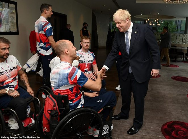 The Prime Minister shook hands with Paralympic athletes at a homecoming event celebrating their successes
