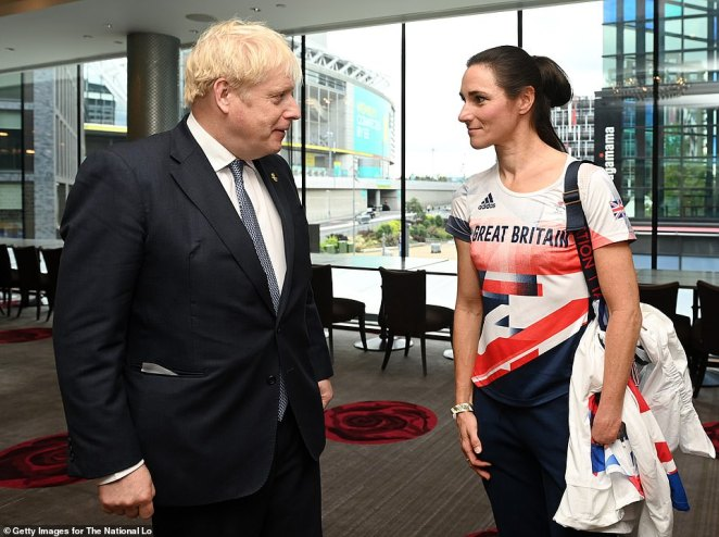 Mr Johnson speaks to cyclist Dame Sarah Storey at the National Lottery's ParalympicsGB Homecoming