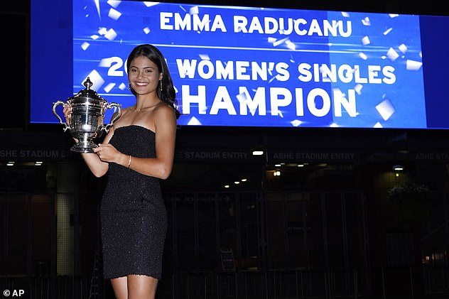 Emma Raducanu was jubilant last night as she stepped out in a glimmering black dress to celebrate her outstanding win at the US Open