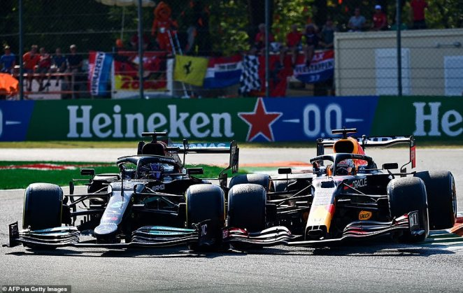 The two championship rivals jostled for position on the chicane after Hamilton had just emerged from the pit lane