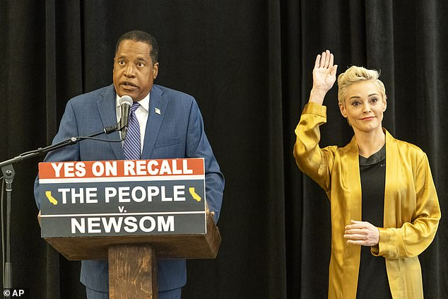 Former actress and activist Rose McGowan holds a news conference with Republican conservative radio talk show host Larry Elder at the Luxe Hotel Sunset Boulevard in Los Angeles Sunday