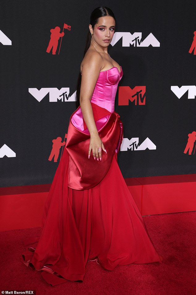 From the side: The massive red bow hung at the sides of her waist and was lined with pink to match the corset