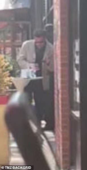 Jennifer Lopez shows boyfriend Ben Affleck around the Bronx where he stops for a cigarette