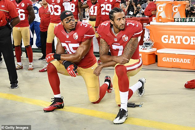 Eric Reid (left) and Colin Kaepernick (right) protest racist police brutality before a 2016 game