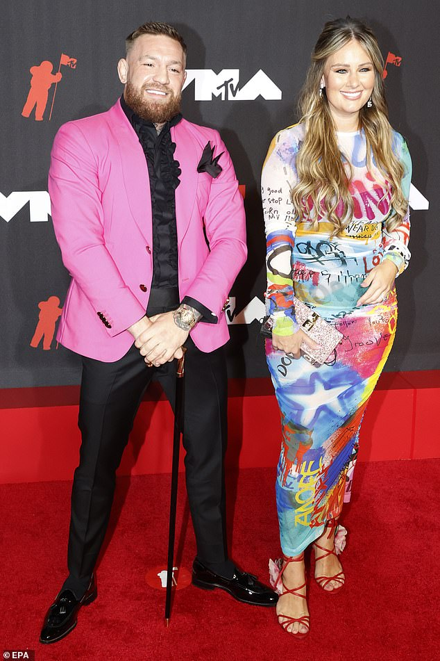 Colorful: Before all the drama played out, the former featherweight and lightweight UFC champion soaked in the spotlight of the red carpet his wife Dee Devlin at his side