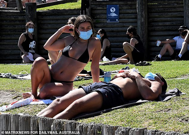 Dr Nick Coatsworth, a former deputy chief medical officer, concurred that being outside was safe (pictured are sunbakers at North Bondi)