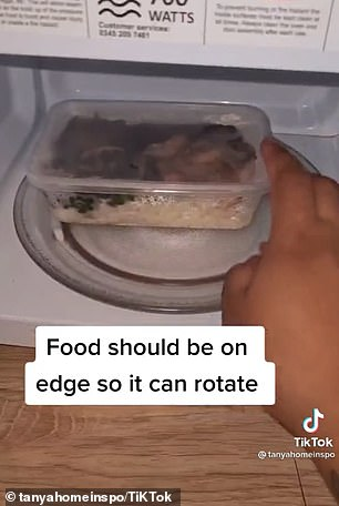 In the TikTok video, Tanya positioned a container of food on the edge of the rotating microwave plate rather than in the middle