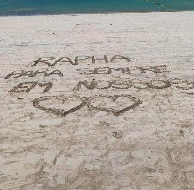 Loved ones in Brazil have shared a photo of a tribute inscribed on the beach Portuguese, which translates in English to: 'Rapha forever in our hearts'