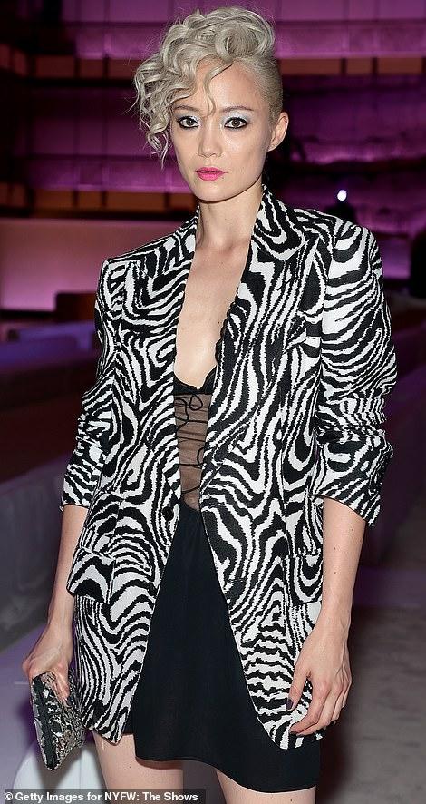 Showing her stripes: Pom Klementieff donned a little black dress and zebra jacket