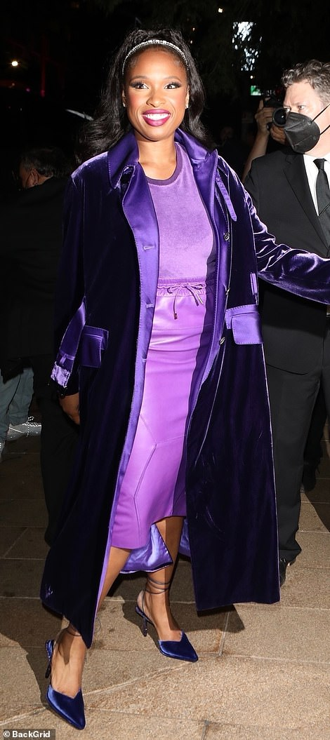 Ensemble: She wore a violet-hued satin and velvet coat with a soft grape-colored top, a shiny, patent leather skirt and blue velvet shoes