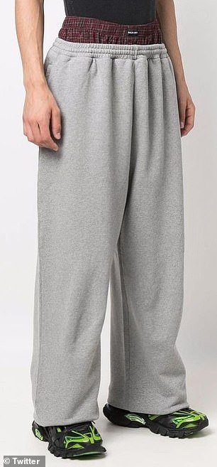 Pictured: A model wearing 'Tropme-l'Oeil' gray sweatpants has an open boxer short built-in over the waistband