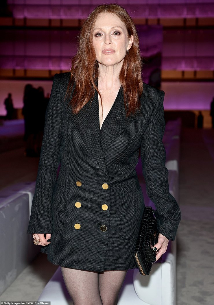 Stunning: Moore, 60, put her best foot forward in a double-breasted coat-dress with shiny gold buttons, square shoulders and a deep neckline that teased her bare chest