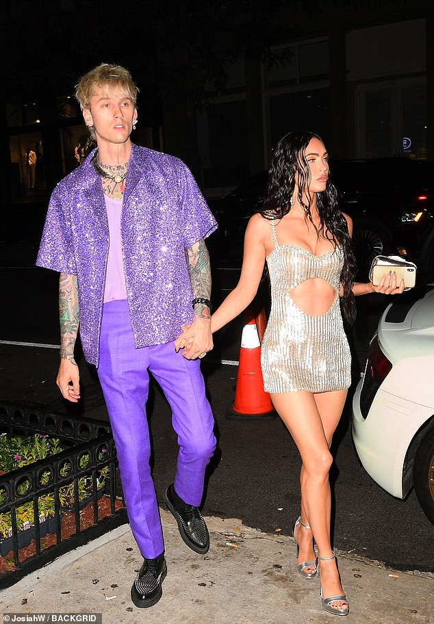 Striking:MGK had changed back into a sequined violet shirt with a lavender undershirt and purple pants, which he wore earlier in the evening when he accepted the moon person for Best Alternative Video for My Ex's Best Friend