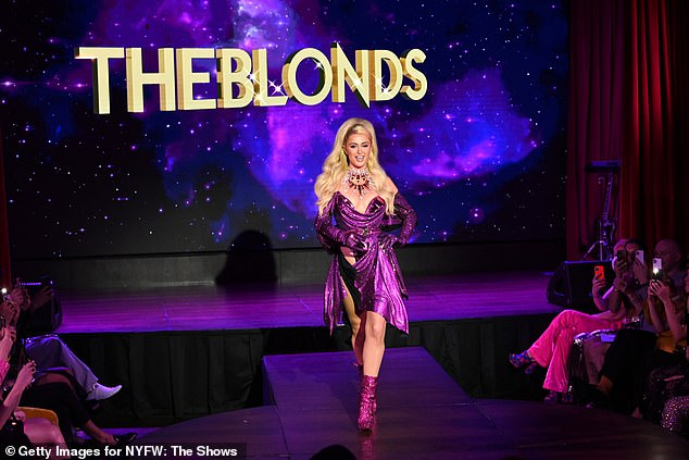 Kicking it off: Paris opened the show in a purple sequin off the shoulder gown which also featured an armor-like bodice
