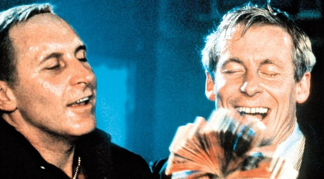 Rogerson has always maintained Smith was no more than a valuable informant for the Armed Hold-Up Squad. Smith insisted the pair became partners in crime. Tony Martin is pictured left playing Smith and Richard Roxburgh as Rogerson in the television series Blue Murder