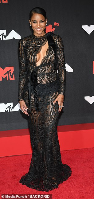 Gorgeous: The 35-year-old hitmaker dared to bare in a lacy black sheer dress featuring a large cutout at the chest at the star-studded event in Brooklyn, New York