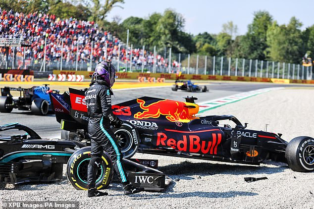 Hamilton took a moment to inspect the respective damage suffered by the two cars