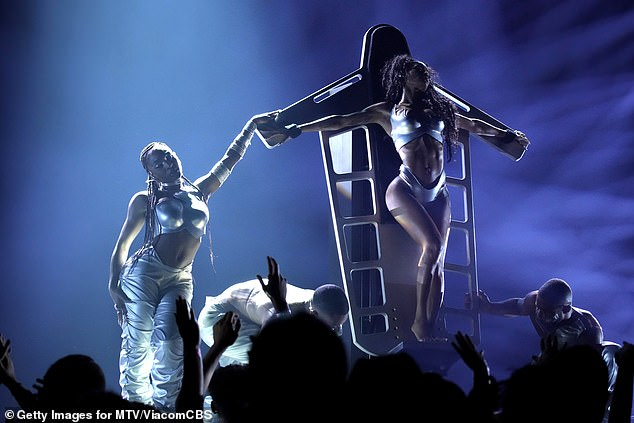 Teyana:During a brief interlude, Normani asked, 'VMAs, how you al feeling?' as a large silver bondage board was wheeled out onto the stage with Taylor strapped to it