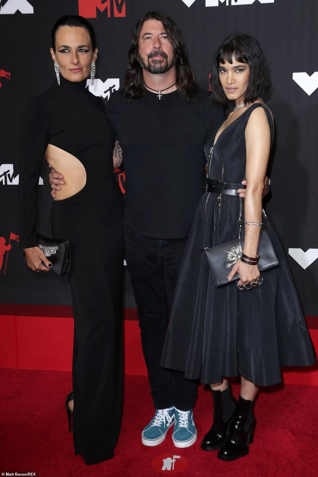 Family affair: Rocker Dave Grohl, who will receive the first-ever VMAs Global Icon award this year, brought friend Paola Kudacki and also posed up with actress Sofia Boutella