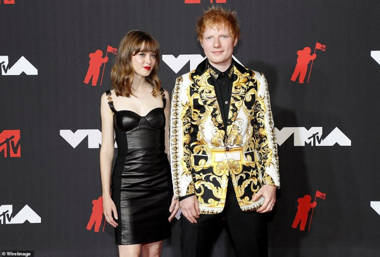Very Versace: The hitmaker walked the red carpet with his protegé Maisie Peters