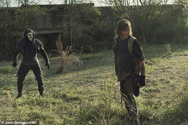 Too many: Daryl was surrounded by Reapers, however, who tied him up and dragged him to their compound with a hood over his head