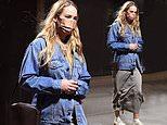 Pregnant Jennifer Lawrence wraps her bump in an oversized denim jacket
