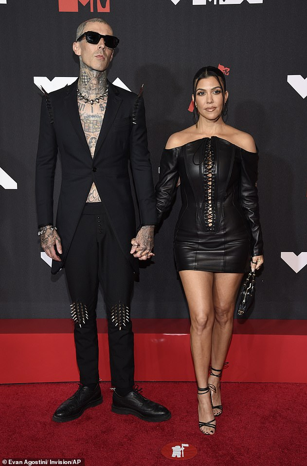 Double trouble: Kourtney Kardashian and Travis Barker looked like quite the pair at Sunday's VMAs in Brooklyn, New York